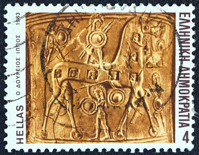 Selo representando o Cavalo de Troia. A imagem remete à vitória dos gregos, que teria ocorrido durante o período pré-homérico.*